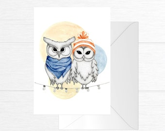 Greeting card depicting two owls in love perched on a Garland of lights - fine tip and watercolor