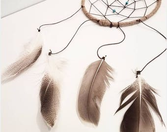 Dreamcatcher with feathers and turquoise beads