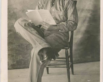 1923 Young Man High Heeled Shoes Legs Crossed Reads Magazine RPPC