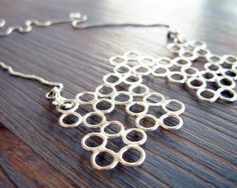 "Molecule. Versatile Silver Lace Statement Pendant Necklace. Hand Made Silver Neck piece. Inspired By Science. Featured on ""Design-Milk""."