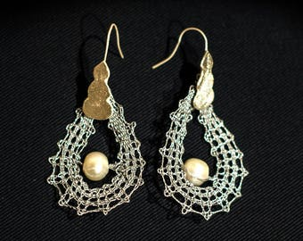 Waves: bobbin lace pendants with pearl and sterling silver base