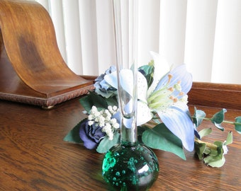 A classic 1970s controlled bubble bud vase in a delightful shade of green