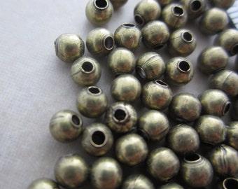 200 antique brass beads 4mm