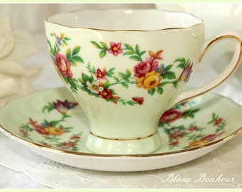 Colclough, England: Light green corset tea cup and saucer with flowers