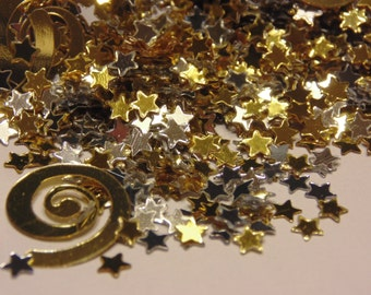 tiny silver and gold star and swirl confetti / sequins, 3-15 mm (10)