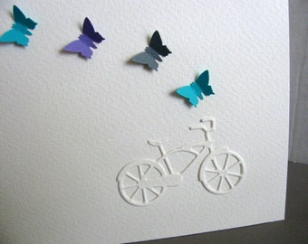 Bicycle with Fluttering Mini Butterflies on Creamy Ivory Watercolour Card. Life is an Adventure. Teal, Purple, Gray or YOUR Colour Choices