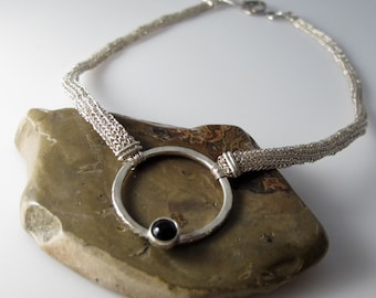 Black Onyx Circle Necklace with Handwoven Chain and Hammered Sterling Silver.