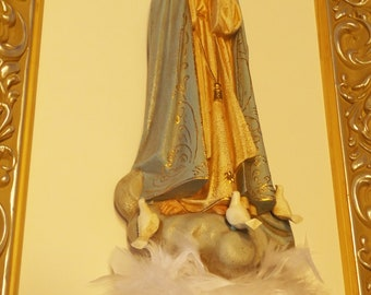 Frame with sculpture of Our Lady Of Fatima