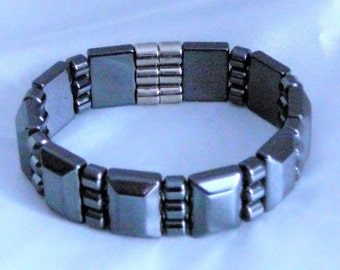 BLACK HEMATITE MAGNETIC Cuff bracelet. Three strand raised hematite spacers with 5 mm drums.