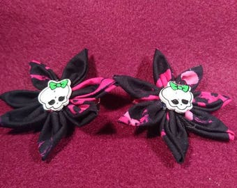 Two handmade black and pink gothic cotton fabric flower hair clips with adorable skull button
