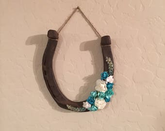 Large brown and teal horseshoe for home