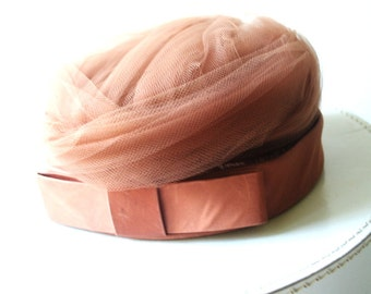 Luxurious vintage 60s light brown pillbox hat with turban style tulle top. Made by Abbye.Size 21