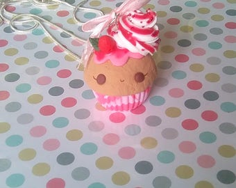 Pendant Strawberry Cupcake with whipped cream and coulis