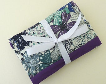 Travel sewing kit in purple floral design.