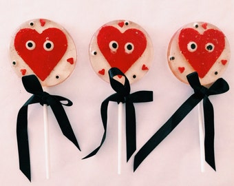 3 Cinnamon flavored Eye Love You lollipops with large marzipan edible glitter hearts and candy eyes