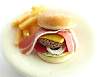 Miniature dish, Hamburger with fried meat and ham, look great and delicious