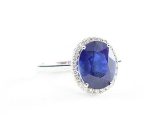 Sapphire and diamond halo ring in 14 carat white gold for her