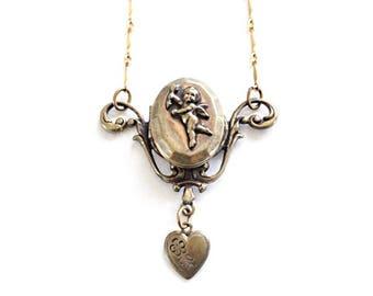 Vintage Pididdly Links Necklace . vintage locket necklace.  brass angel necklace . vintage art nouveau necklace .  pididdly links jewelry