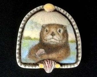 Sea Otter with shell scrimshaw technique reproduction pin