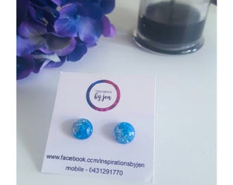 Blue resin and silver leaf earrings.