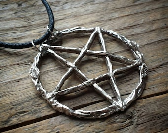 Silver Pentacle amulet decorated with beech leaves