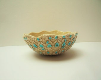 Handmade ceramic Cup shaped by hand with lace imprint