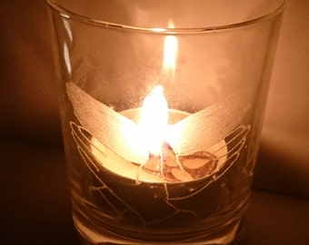 Shadow puppet design, hand engraved glass tea light holder