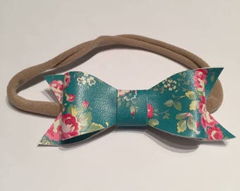 Teal floral faux leather bow on nylon headband