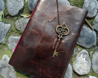 Loose leather notebook, heart wrench