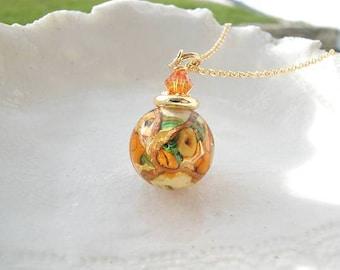 Collier en verre vénitien de Murano ambre ronde