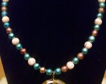 Handmade Beaded Necklace with Swirly Glass Pendant in Blue, Bronze and White
