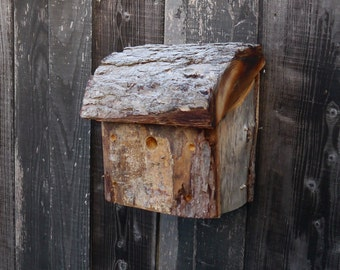 Birdhouse handmade from reclaimed larch