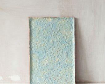 Handmade turquoise and yellow ceramic vanity tray with decorative imprint