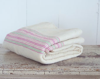 Hand Woven Blanket in a White Cream Color With Green and Pink Stripes