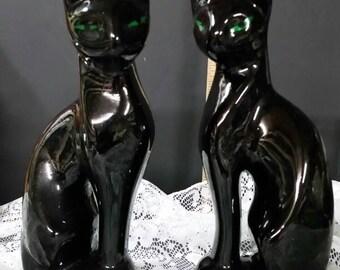 Vintage set of black ceramic cats.