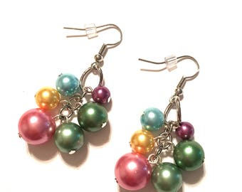 Earrings. Cluster of colorful pearl colored beads on silver colored ear wires.