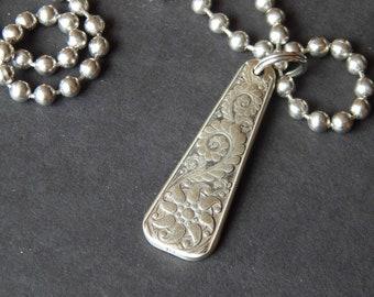 Unique, silver plated pendant