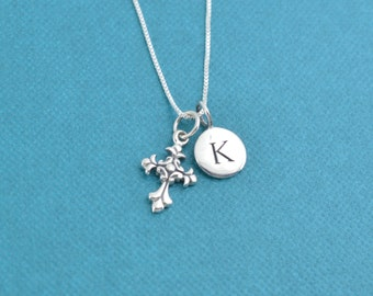 "Little girl's cross necklace in sterling silver on a 14"" sterling silver box chain and personalized with a sterling silver initial disk."