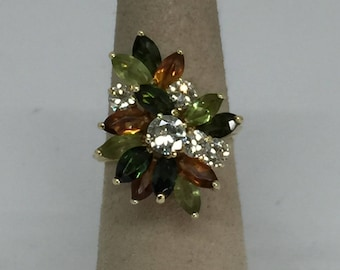 cool vintage 18k yellow gold cluster ring set with 1 carat of diamonds with peridot, tourmaline and citrine