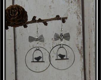 Birds in silver circles earrings