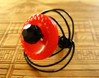 Red Button and Black Wire Ring
