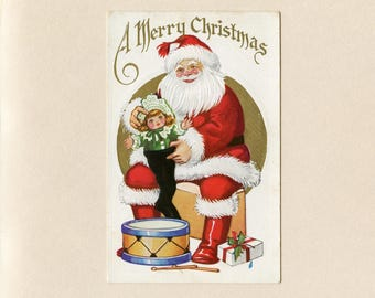 Vintage Christmas Postcard Santa Claus in Red Suit Putting Doll in Stocking Drum White and Gold Embossed Unused - 8779Pb