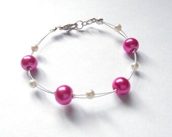 Bracelet pearls - ivory & Fuchsia.