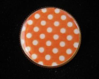 Orange ring with white polka dots on bottom