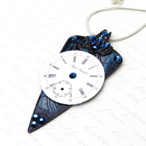 Dark, dramatict Necklace with stormy deep blue background, vintage Bijou Watch Company pocket watch dial, and Swarovski Crystal
