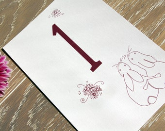 Wedding Breakfast Table Numbers/Names with classic hugging bunnies design.