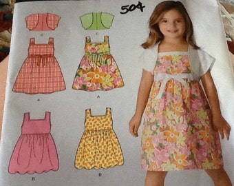 Simplicity Girls Sleeveless dress with shrug, uncut Size 3-8