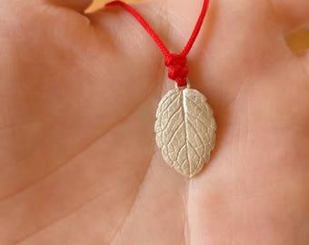 A 999 silver mint pendant, necklace