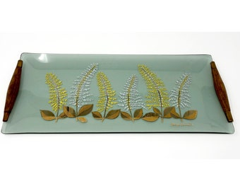 1960's Georges Briand signed bent glass tray with wood handles. Smoke grey glass with gold, yellow & white fern/goldenrod design