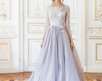 Lavender wedding gown with sheer sleeves and floral appliques floating down the bodice // Lalaing wedding dress
